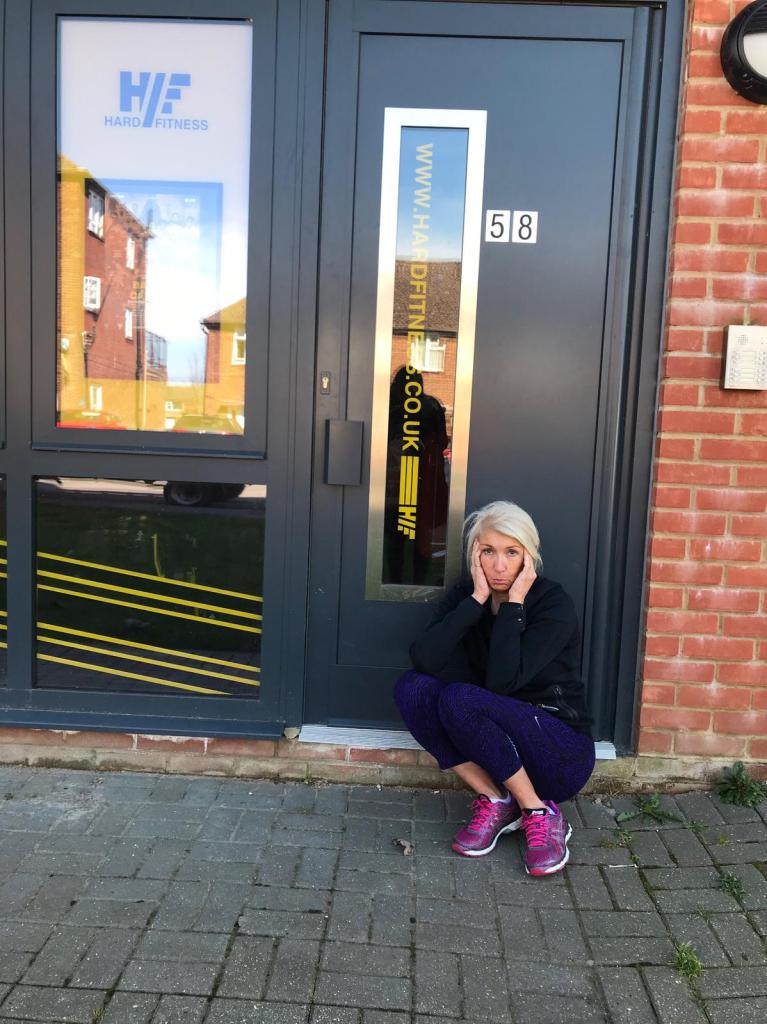 fitness over 50 Jayne sitting outside closed gym